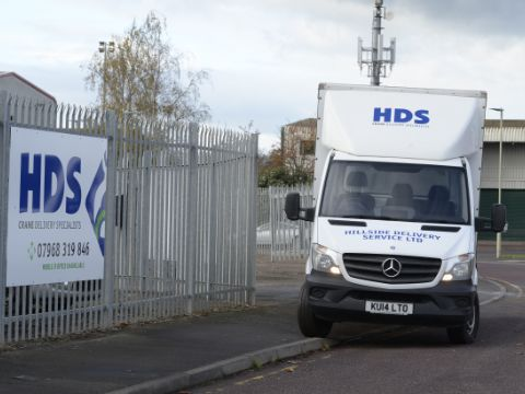 White HDS Van on the site of a curb by a road corner